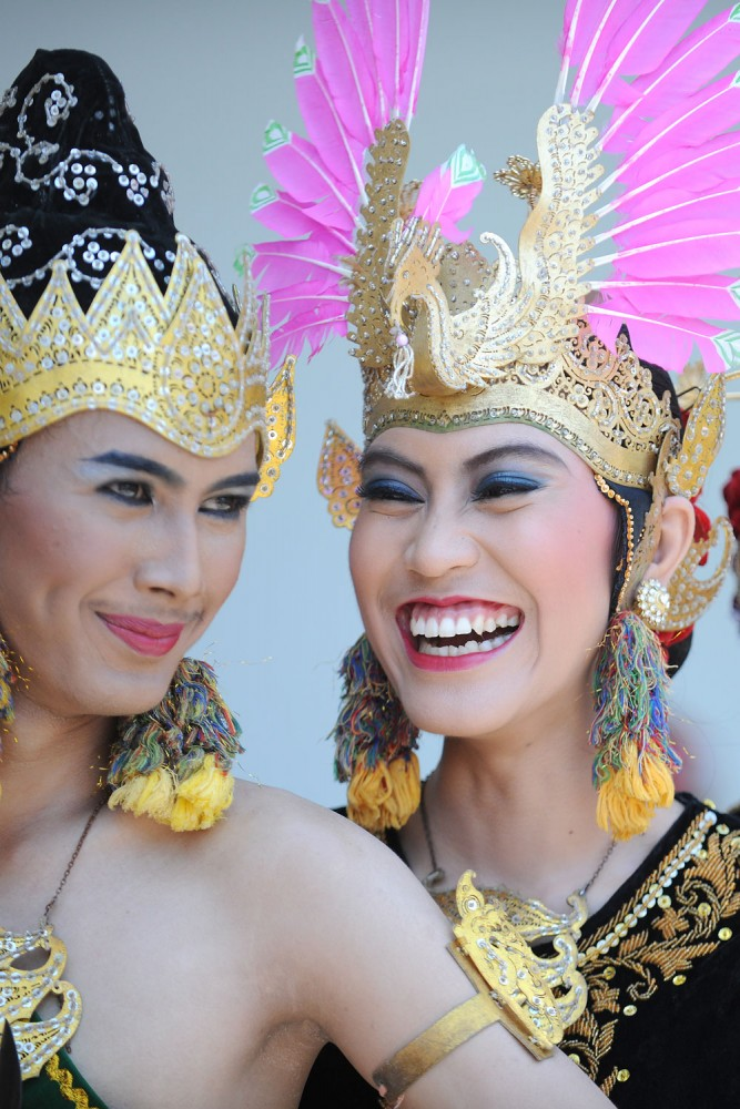 Traditional Dancers caught in a playful moment that the Sultan's Palace, Yogyakarta