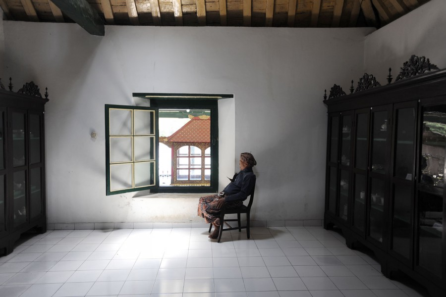 A guard snoozes at the Sultan's Palace, Yogyakarta, Indonesia.